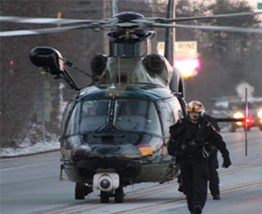 Maryland State Trooper pilot walking beside MSP Helicopter